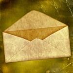 Vintage envelope on a grunge old paper — Stock Photo #5477934