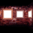 Royalty-Free Stock Photo: Art gallery. Frames old leather on a brickwall.