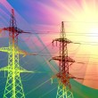 Electric power transmission towers at sunset - Stock Photo