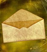 Grunge eski bir kağıt üzerinde eski zarfı — Stok fotoğraf