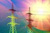 Electric power transmission towers at sunset — Stock Photo