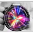 Stock Photo: Photographing lens in hands of photographer