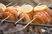 BBQ shrimp at a picnic in the forest — Stock Photo