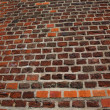 Fragment of an old brick wall - Stock Photo