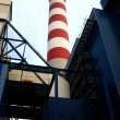 Red and white high industrial chimney — Stock Photo