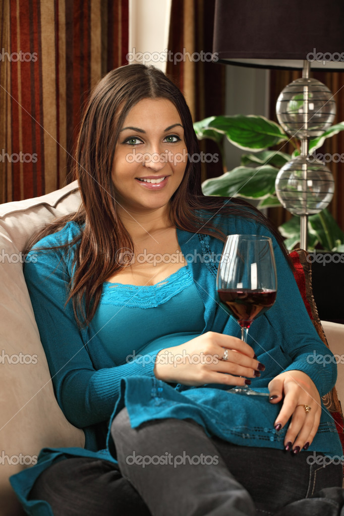 Photo of a beautiful female drinking red wine at home. — Stock Photo #5636568
