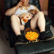 Hamburger eating lazy couch potato - Foto Stock