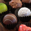 Assorted chocolates in wrappers - Stock Photo
