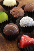 Assorted chocolates in wrappers — Stock Photo