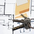 Stock Photo: House plans and key