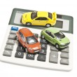 Cars on calculator — Stock Photo