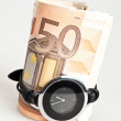 Money and clock — Stock Photo