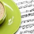 Coffee and musical score — Stock Photo