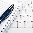 Notebook on keyboard — Stockfoto