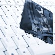 Credit card on keyboard - Stock Photo