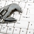 Hand tool on keyboard — Stock Photo