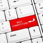Beat competitors key — Stock Photo