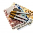 Cigarette on money — Stock Photo #6238927