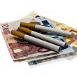 Cigarette on money — Stock Photo #6238928