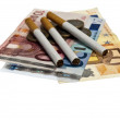 Cigarette on money — Stock Photo #6238929