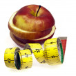 Measurement tape and apple — Stock Photo