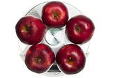 Red apples on food scale — Stock Photo
