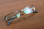 Eye glasses on desk — Stock Photo