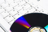 Klávesnice a cd-rom — Stock fotografie