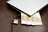 Laptop and money — Stock Photo
