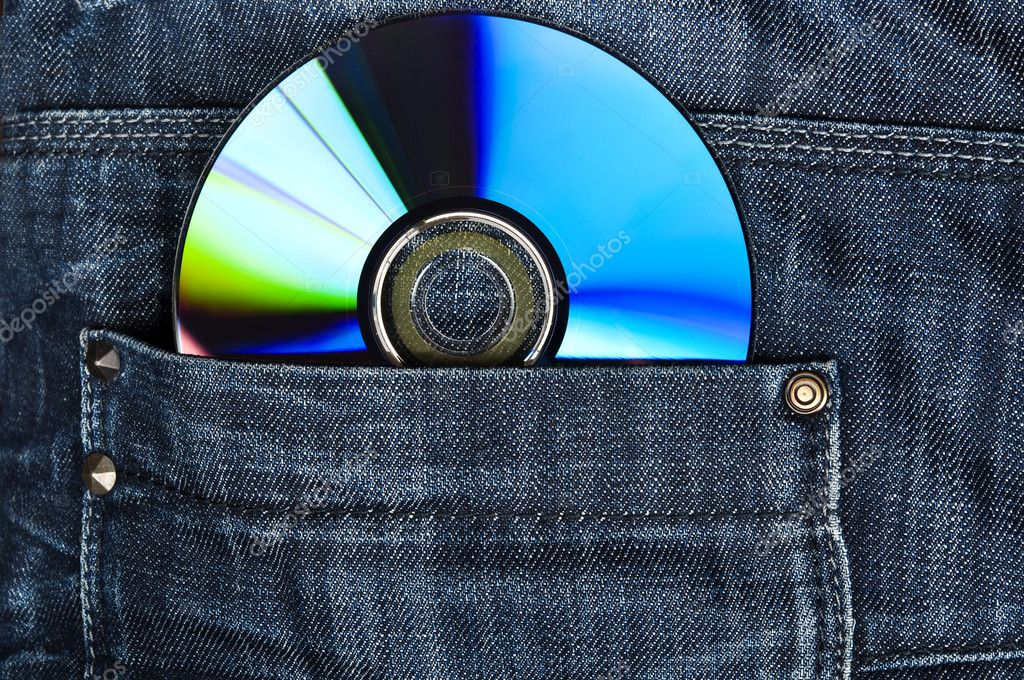 Closeup to jeans pocket with cd — Stock Photo #6236787
