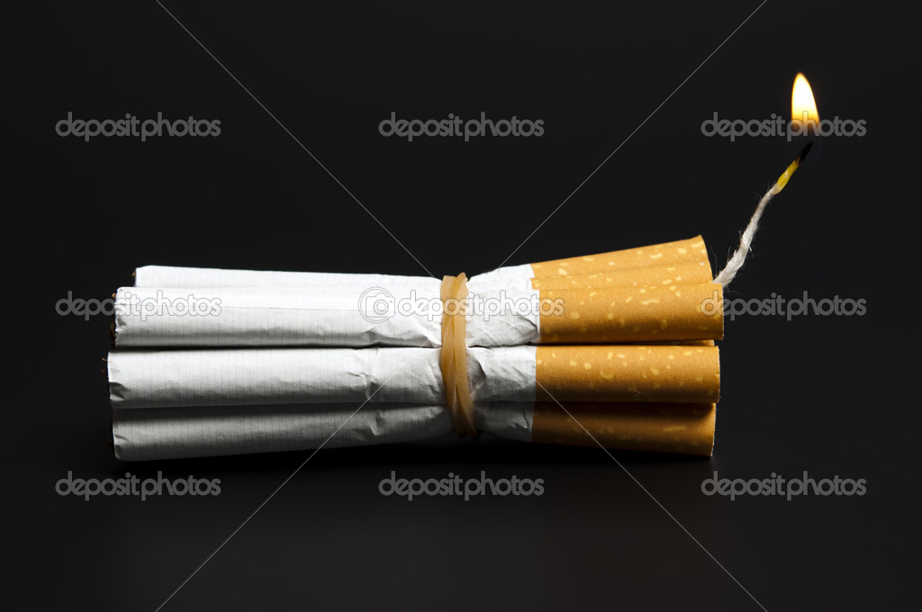 Cigarettes in dynamite concept on black — Stock Photo #6239121