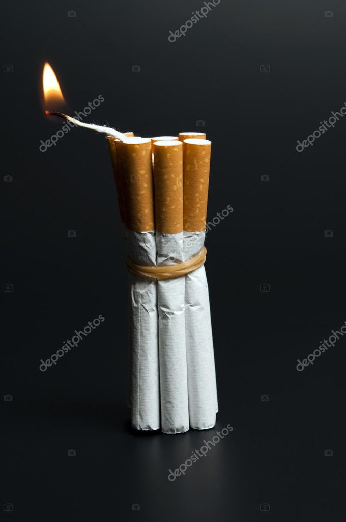 Cigarettes in dynamite concept on black — Stock Photo #6239153