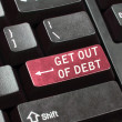 Get out of debt key — Stock Photo
