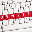 Identity word on keyboard - Stock Photo