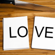 Knife cut paper with love — Stock Photo