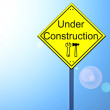 Under construction on road sign — Stock Photo
