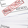 Investment stamp on financial paper — Stock Photo