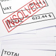 Stock Photo: Insolvent stamp on financial paper