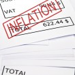 Inflation stamp on financial paper - Stock Photo