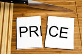 Knife cut paper with price — Stock Photo