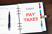 Pay taxes message — Stock Photo