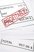 Profitable stamp on financial paper — Stock Photo