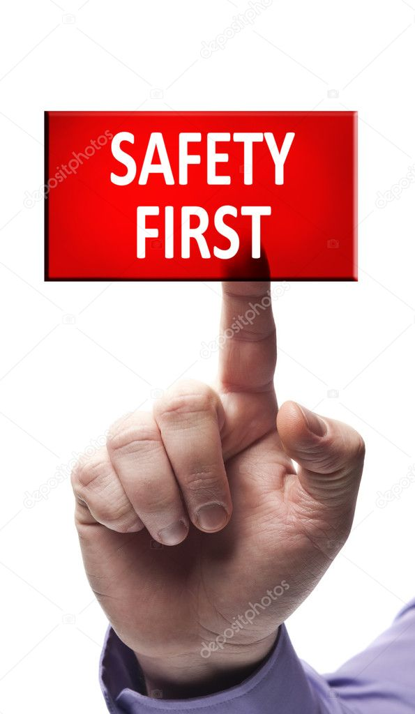Safety first button pressed by male hand  Stock Photo #6240579