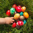 Hand taking Easter egg — Stock Photo