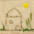 Stone house illustration in sand — Stock Photo #5686181