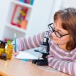 Teen science girl with microscope — Stock Photo