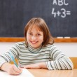 Elementary school girl practicing — Stock Photo
