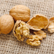Stock Photo: Walnuts on homespun linen background