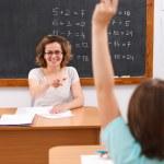 School girl raising arm — Stock Photo