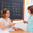 Schoolgirl giving or receiving math test paper — Stock Photo